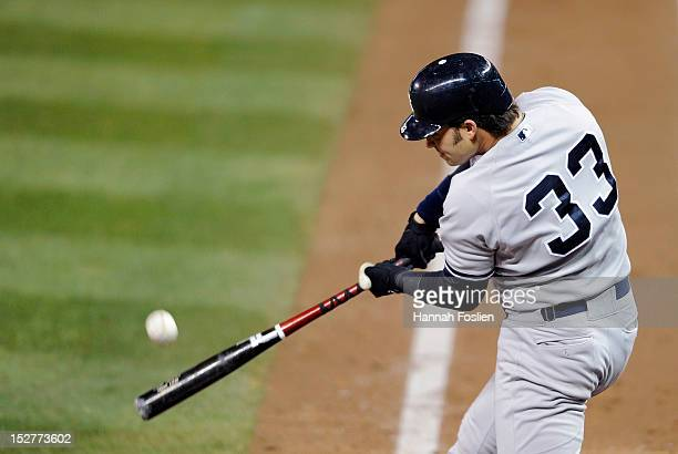 Nick Swisher of the New York Yankees hits a two run home run against the Minnesota Twins during the fourth inning of the game on September 25 2012 at...