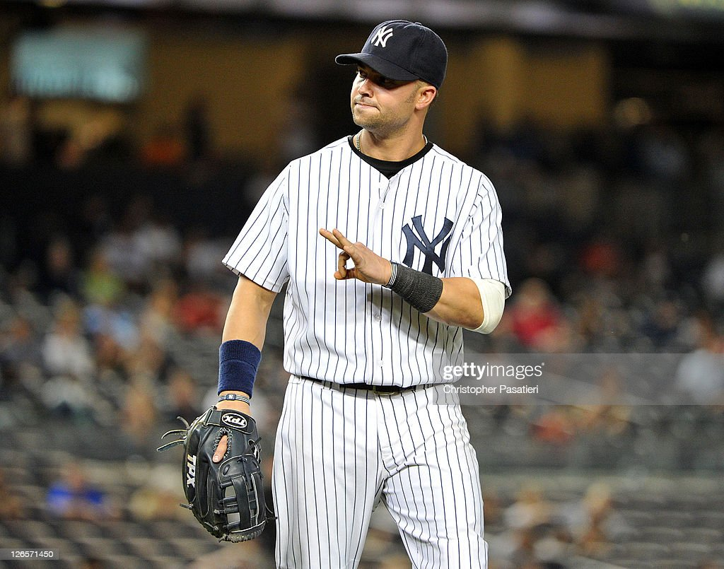 <a gi-track='captionPersonalityLinkClicked' href=/galleries/search?phrase=Nick+Swisher&family=editorial&specificpeople=206417 ng-click='$event.stopPropagation()'>Nick Swisher</a> #33 of the New York Yankees motions towards the dugout after Dustin Pedroia #15 of the Boston Red Sox (not pictured) was called safe sliding in to first base in the top of the 13th inning on September 25, 2011 at Yankee Stadium in the Bronx borough of New York City.