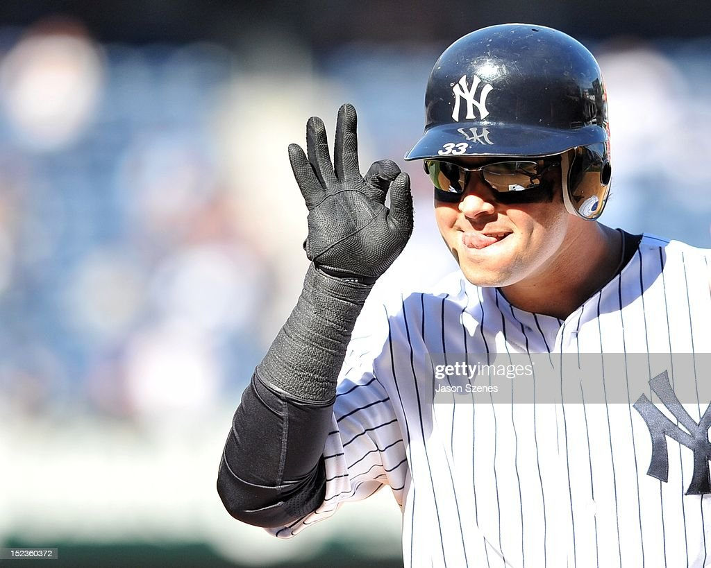 <a gi-track='captionPersonalityLinkClicked' href=/galleries/search?phrase=Nick+Swisher&family=editorial&specificpeople=206417 ng-click='$event.stopPropagation()'>Nick Swisher</a> #33 of the New York Yankees reacts after connecting on an RBI single in the ninth inning against the Toronto Blue Jays during the first game of a double header at Yankee Stadium on September 19, 2012 in the Bronx borough of New York City.