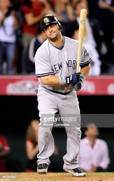 Nick Swisher of the New York Yankees reacts after popping out ending the ninth inning of Game Five of the ALCS against the Los Angeles Angels of...