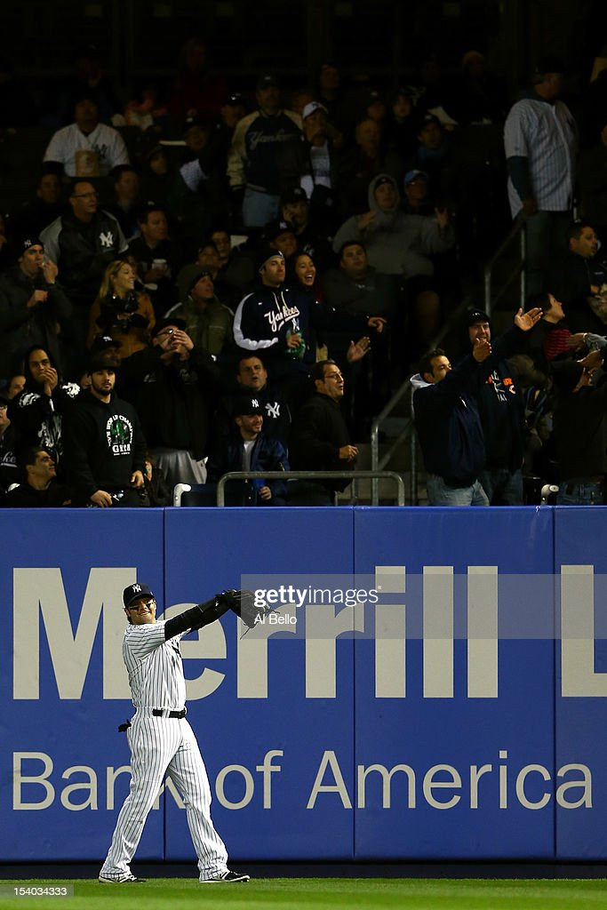 Nick Swisher #33 of the New York Yankees reacts to a foul ball during Game Five of the American League Division Series at Yankee Stadium on October 12, 2012 in New York, New York.