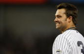 Nick Swisher of the New York Yankees smiles while standing at first base during the game against the Tampa Bay Rays on September 9 2009 at Yankee...