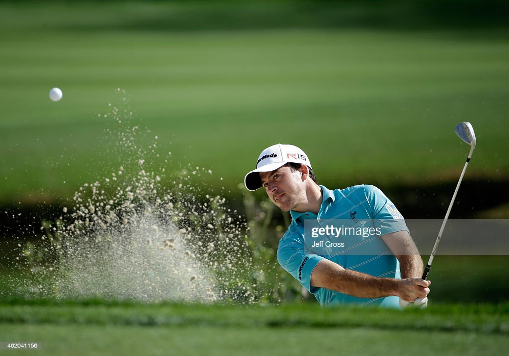 Nick Taylor of Canada hits a bunker shot on the 12th hole during round two of the Humana Challenge in partnership with The Clinton Foundation at the...