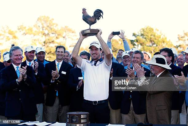 Nick Taylor of Canada is presented with the trophy and check after winning the Final Round of the Sanderson Farms Championship at The Country Club of...
