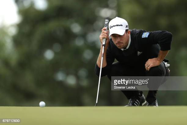 Nick Taylor of Canada lines up a putt on the third green during round three of the Wells Fargo Championship at Eagle Point Golf Club on May 6 2017 in...