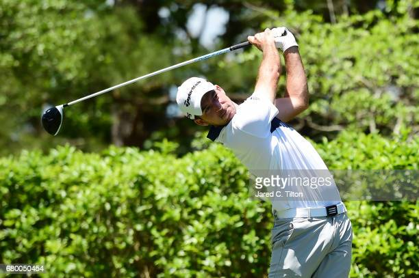 Nick Taylor of Canada plays his shot from the fourth tee during the final round of the Wells Fargo Championship at Eagle Point Golf Club on May 7...
