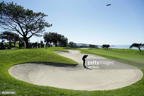Nick Taylor of Canada plays his shot out of the bunker on the fifth hole during the third round of the Farmers Insurance Open at Torrey Pines South...