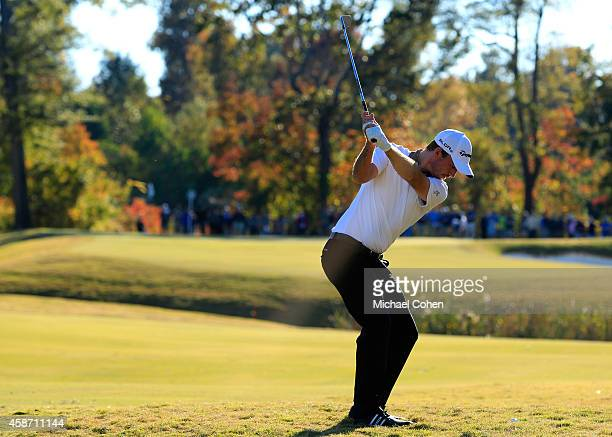 Nick Taylor of Canada takes his second shot on the 16th hole during the Final Round of the Sanderson Farms Championship at The Country Club of...