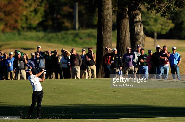Nick Taylor of Canada takes his second shot on the 18th hole during the Final Round of the Sanderson Farms Championship at The Country Club of...