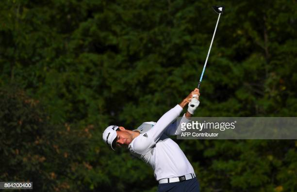 Nick Taylor of Canada tees off on the 3rd hole during the third round of the CJ Cup at Nine Bridges in Jeju Island on October 21 2017 / AFP PHOTO /...