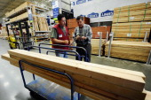 Nick Teichtmann with the help of Lowe's employee Jaime Solis buys lumber to renovate his house by adding a gazebo on top of a deck and fixing his...