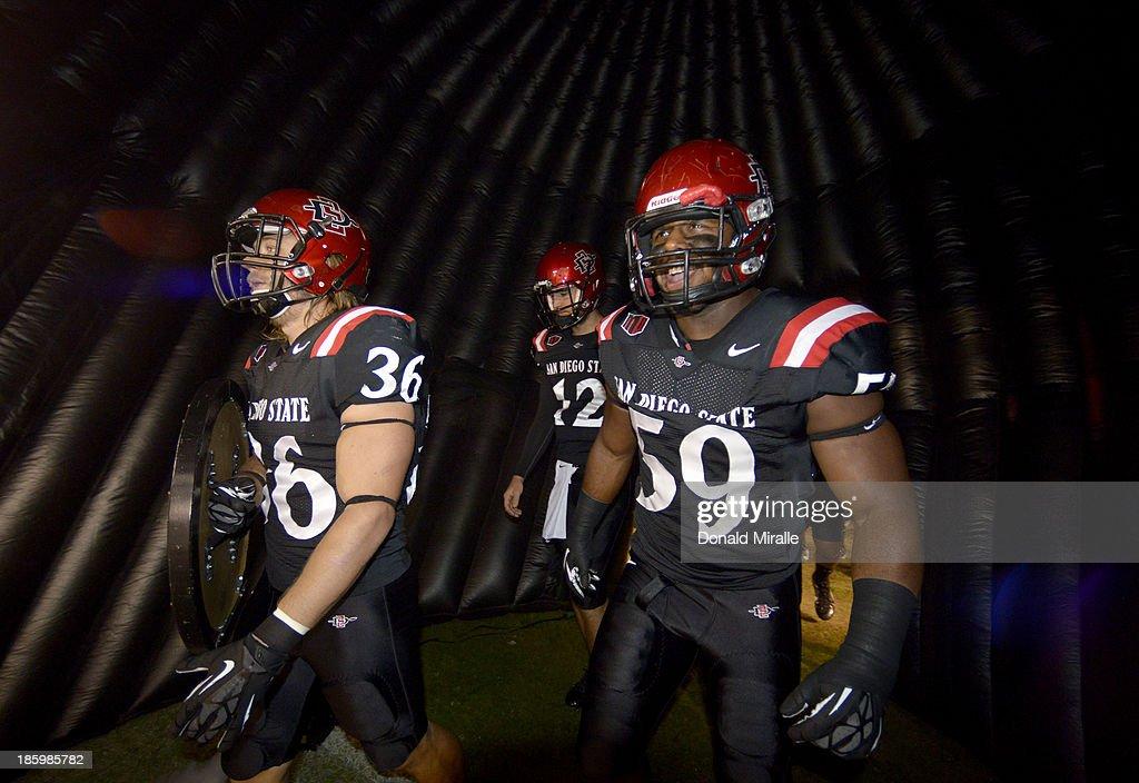 Nick Tenhaeff #36, Jake Bernards #12, and Jordan Thomas #59 of the San Diego State Aztecs enter the game against the Fresno State Bulldogs on October 26, 2013 at Qualcomm Stadium in San Diego, California.