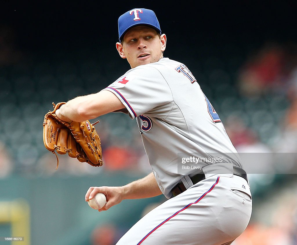 Nick Tepesch #49 of the Texas Rangers pitches in the first inning Houston Astros at Minute Maid Park on May 12, 2013 in Houston, Texas.