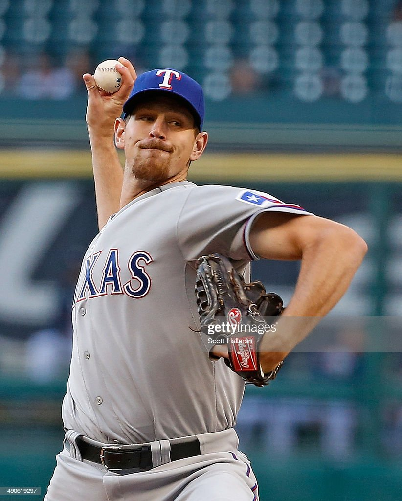 Nick Tepesch #23 of the Texas Rangers throws a pitch in the first inning of their game against the Houston Astros at Minute Maid Park on May 14, 2014 in Houston, Texas.