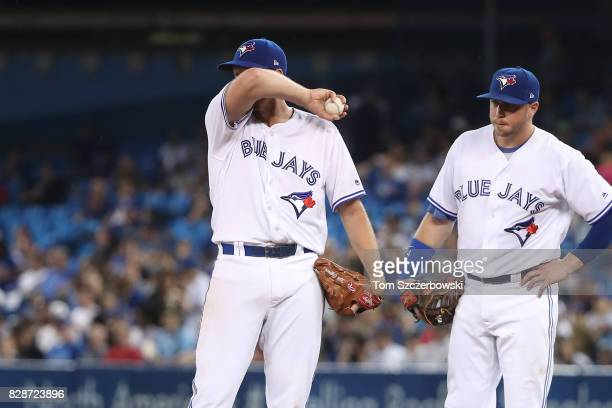 Nick Tepesch of the Toronto Blue Jays waits on the mound moments before being relieved as the manager is on his way to make a pitching change as...