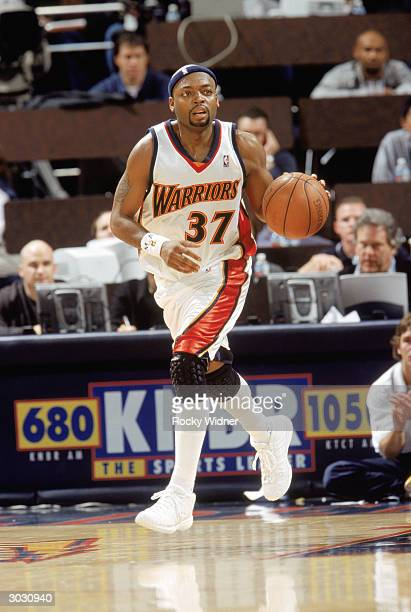 Nick Van Exel of the Golden State Warriors drives down the court against the Portland Trail Blazers at The Arena in Oakland on February 20 2004 in...