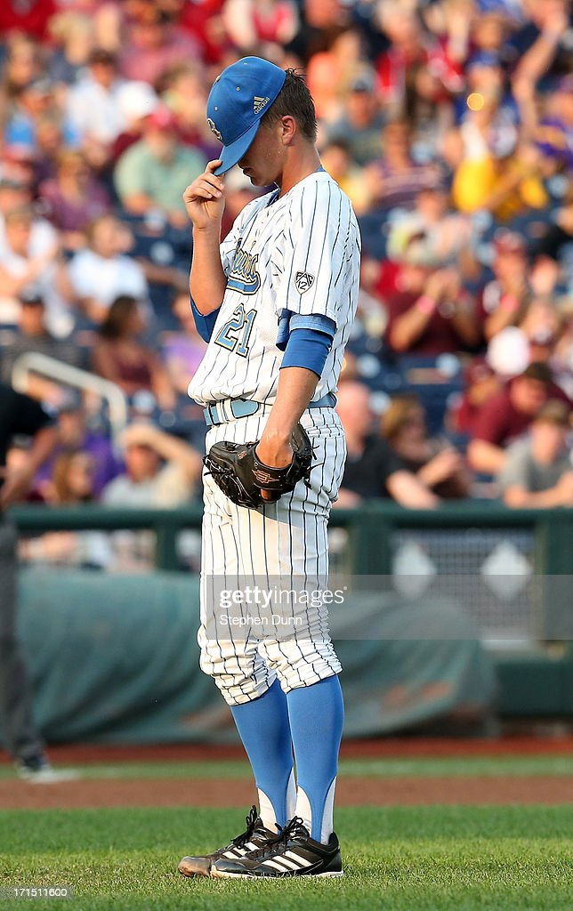 Nick Vander Tuig #21 of the UCLA Bruins prepares to throw the first pitch against the Mississippi State Bulldogs during game two of the College World Series Finals on June 25, 2013 at TD Ameritrade Park in Omaha, Nebraska.