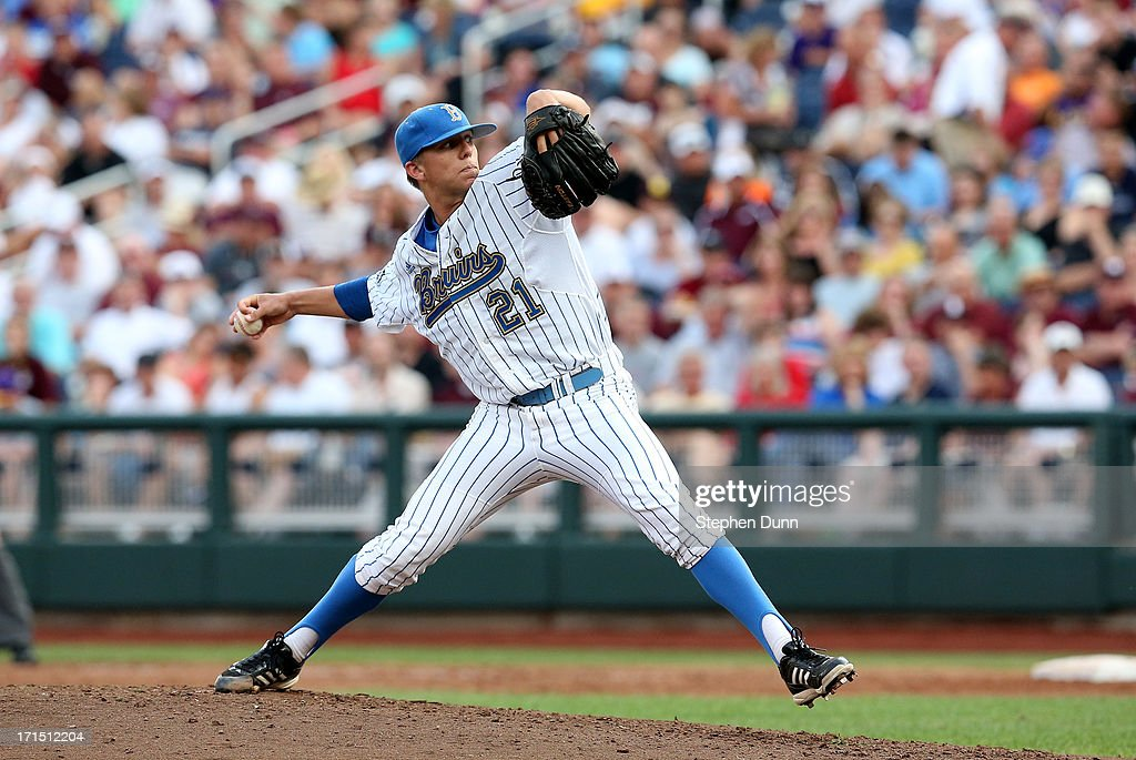 Nick Vander Tuig #21 of the UCLA Bruins throws a pitch against the Mississippi State Bulldogs during game two of the College World Series Finals on June 25, 2013 at TD Ameritrade Park in Omaha, Nebraska.