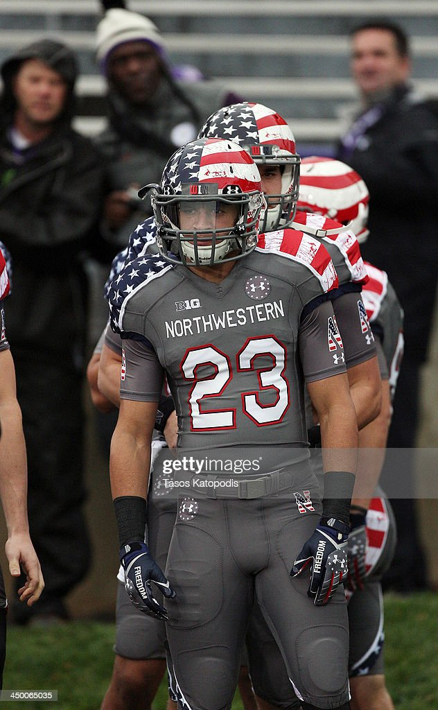 Nick VanHoose # 23 of Northwestern Wildcats takes the field with there Wounded Warrior Project uniform before they take on Michigan Wolverines at Ryan Field on November 16, 2013 in Evanston, Illinois.
