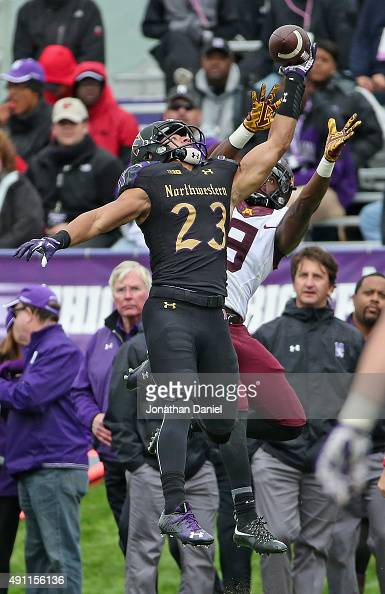Nick VanHoose of the Northwestern Wildcats breaks up a pass intended for Eric Carter of the Minnesota Golden Gophers at Ryan Field on October 3 2015...