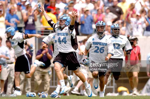Nick Veith of Johns Hopkins charges on to the field with teammates following the Division I Men's Lacrosse Championship help at Lincoln Financial...