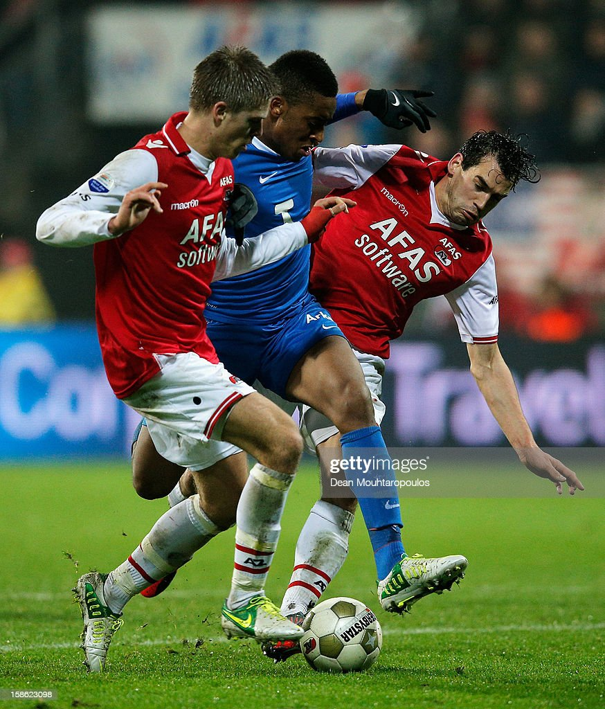Nick Viergever (L) and Dirk Marcellis (R) of AZ and Leroy Fer (C) of Twente battle for the ball during the Eredivisie match between AZ Alkmaar and FC Twente at the AFAS Stadium on December 21, 2012 in Alkmaar, Netherlands.
