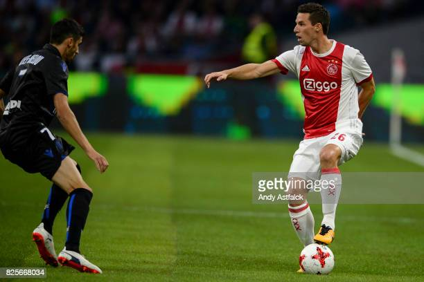 Nick Viergever from AJAX with the ball while Pierre LeesMelou from OSC Nice defending during the UEFA Champions League Qualifying Third Round Second...