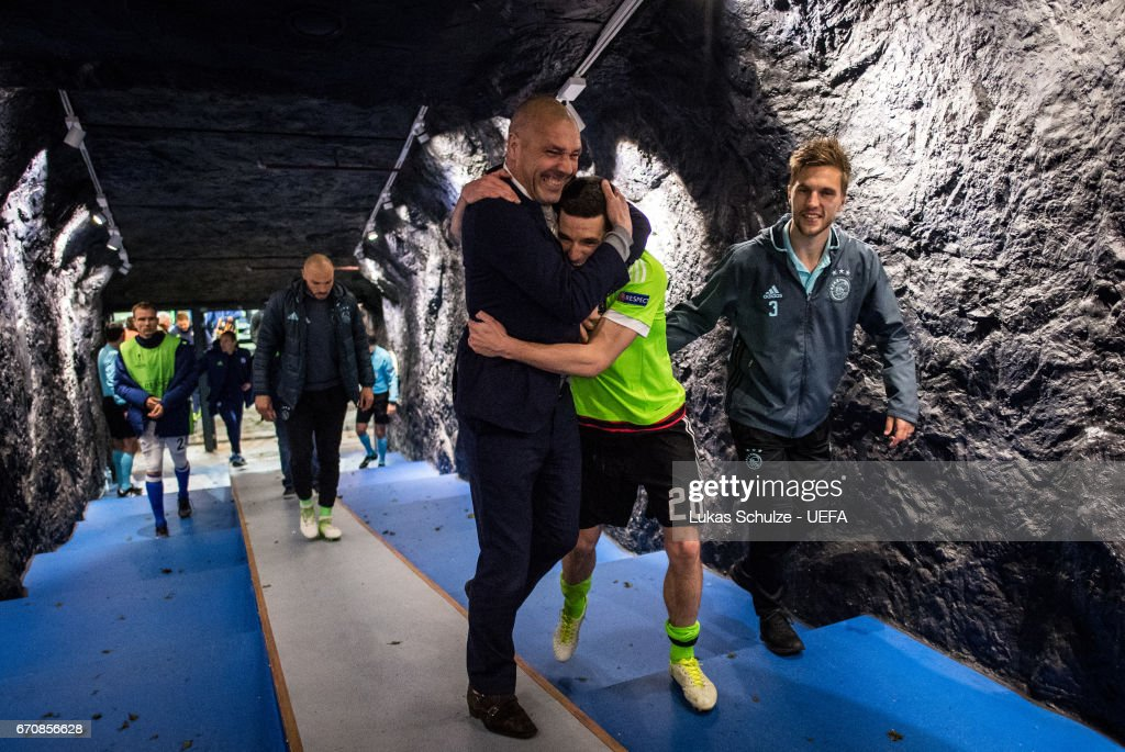 Nick Viergever (M), Joel Veltman (R) and team mates celebrate in the player tunnel after the UEFA Europa League quarter final second leg match between FC Schalke 04 and Ajax Amsterdam at Veltins-Arena on April 20, 2017 in Gelsenkirchen, Germany.