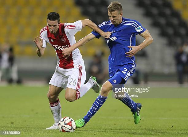 Nick Viergever of Ajax Amsterdam vies with Marvn Friedrich Schalke 04 during the international friendly soccer match between FC Schalke 04 and Ajax...