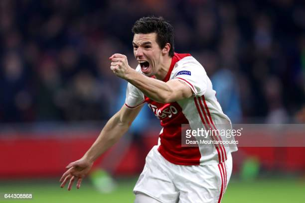 Nick Viergever of Ajax celebrates scoring his sides first goal during the UEFA Europa League Round of 32 second leg match between Ajax Amsterdam and...