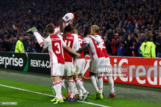Nick Viergever of Ajax celebrates scoring his sides first goal with team mates during the UEFA Europa League Round of 32 second leg match between...