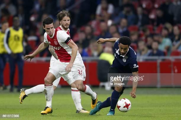 Nick Viergever of Ajax Lasse Schone of Ajax Ryan Sanusi of Sparta Rotterdam during the Dutch Eredivisie match between Ajax Amsterdam and Sparta...