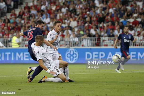 Nick Viergever of Ajax Maxime Le Marchand of OCG Nice Arnaud Souquet of OCG Nice during the UEFA Champions League third round qualifying first leg...