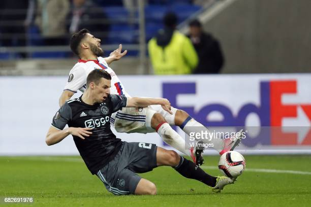 Nick Viergever of Ajax Nabil Fekir of Olympique Lyonnaisduring the UEFA Europa League semi final match between Olympique Lyonnais and Ajax Amsterdam...
