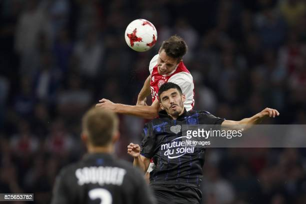 Nick Viergever of Ajax Pierre LeesMelou of OCG Nice during the UEFA Champions League third round qualifying first leg match between Ajax Amsterdam...