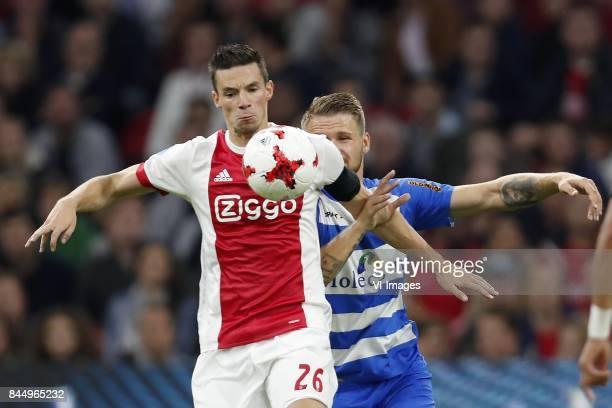 Nick Viergever of Ajax Piotr Parzyszek of PEC Zwolle during the Dutch Eredivisie match between Ajax Amsterdam and PEC Zwolle at the Amsterdam Arena...