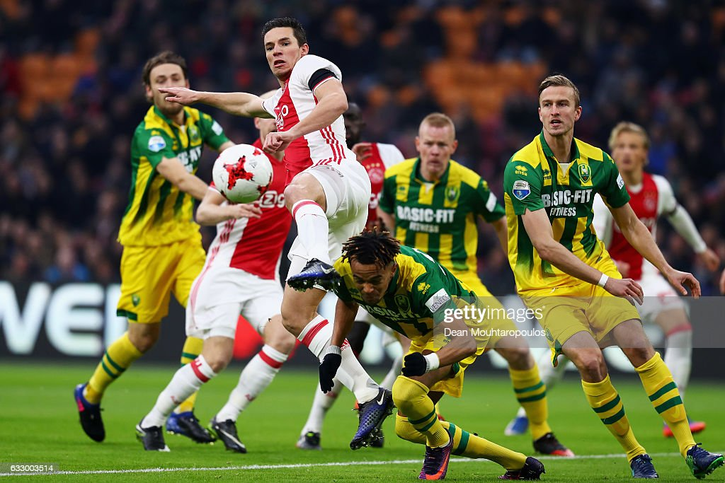 Nick Viergever of Ajax shoots on goal as Trevor David of ADO Den Haag tries to stop him during the Eredivisie match between Ajax Amsterdam and ADO Den Haag held at Amsterdam Arena on January 29, 2017 in Amsterdam, Netherlands.