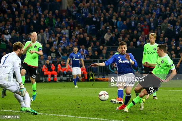 Nick Viergever of Amsterdam scores the first goal for Ajax against Ralf Faehrmann of Schalke during the UEFA Europa League quarter final second leg...