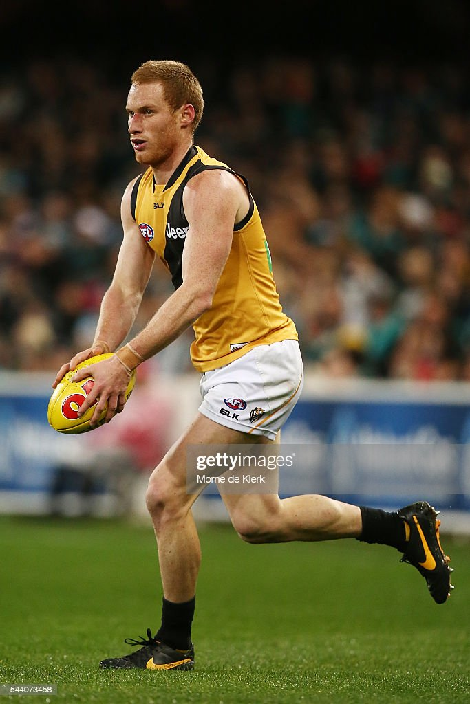 Nick Vlastuin of the Tigers runs with the ball during the round 15 AFL match between the Port Adelaide Power and the Richmond Tigers at Adelaide Oval on July 1, 2016 in Adelaide, Australia.