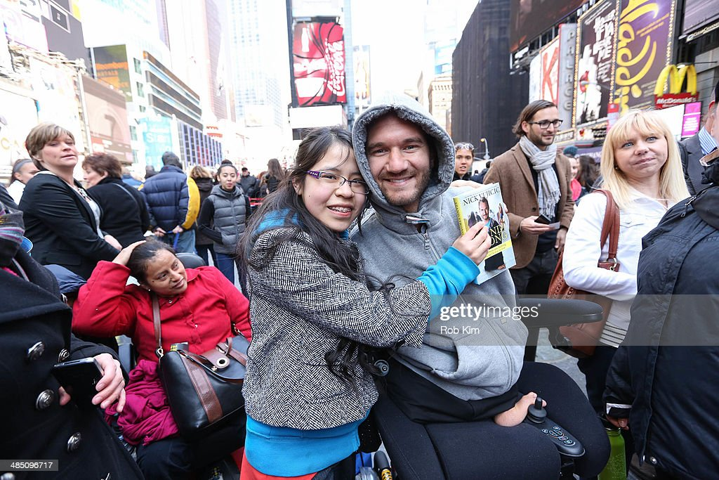 <a gi-track='captionPersonalityLinkClicked' href=/galleries/search?phrase=Nick+Vujicic&family=editorial&specificpeople=5126580 ng-click='$event.stopPropagation()'>Nick Vujicic</a>, New York Times best selling author, motivational speaker and leader of the nonprofit organization Life Without Limbs, greets fans at the 10,000 Hugs Stand Strong Tour at Duffy Square in Times Square on April 16, 2014 in New York City.