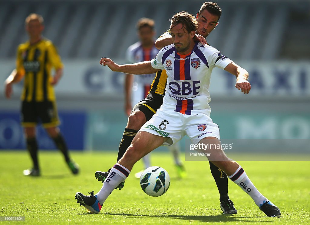 Nick Ward of Perth is tackled by Emmanuel Muscat of Wellington during the round 19 A-League match between the Wellington Phoenix and the Perth Glory at Eden Park on February 2, 2013 in Auckland, New Zealand.