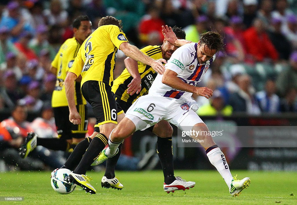 Nick Ward of Perth is tackled during the round eight A-League match between Perth Glory and Wellington Phoenix at NIB Stadium on November 24, 2012 in Perth, Australia.