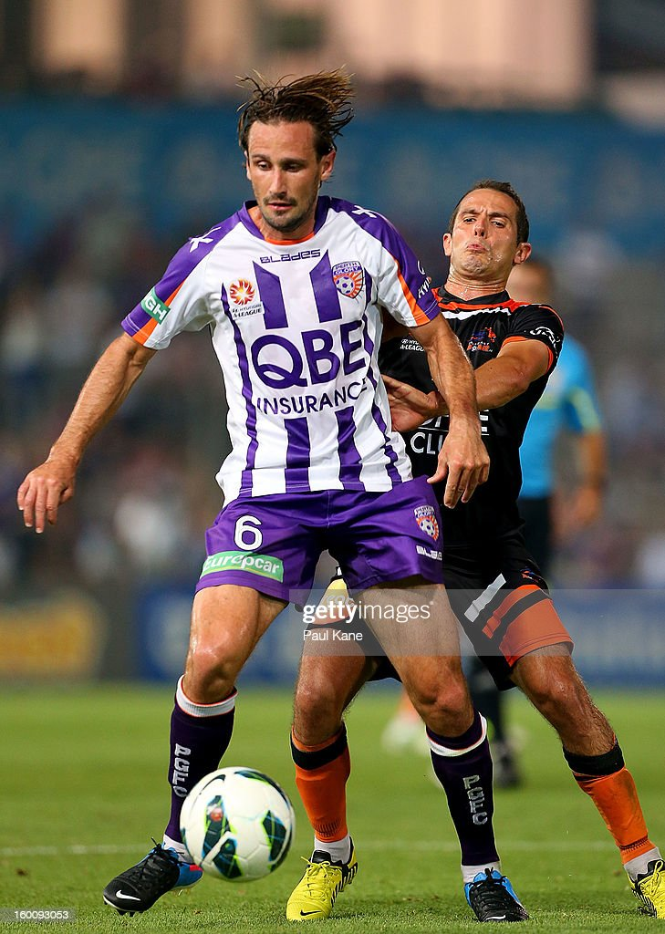 Nick Ward of the Glory is challenged by Massimo Murdocca of the Roar during the round 18 A-League match between the Perth Glory and the Brisbane Roar at nib Stadium on January 26, 2013 in Perth, Australia.