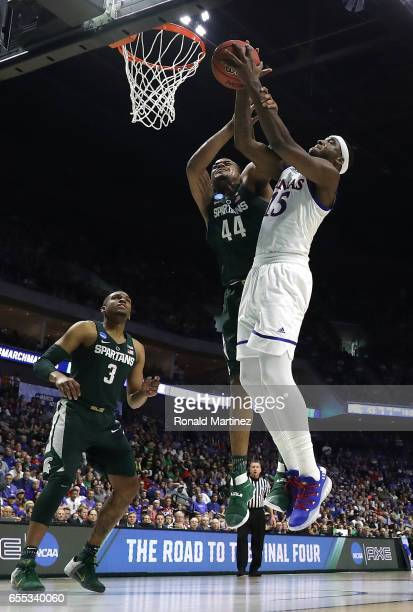 Nick Ward of the Michigan State Spartans battles for the rebound with Carlton Bragg Jr #15 of the Kansas Jayhawks during the second round of the 2017...