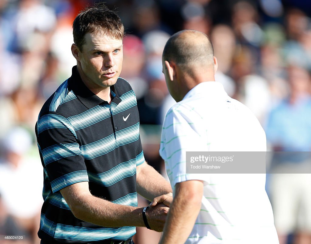 Nick Watney and Bill Haas shake hands after the conclusion of their round on the 18th green during the final round of the Farmers Insurance Open at Torrey Pines South on February 8, 2015 in La Jolla, California.
