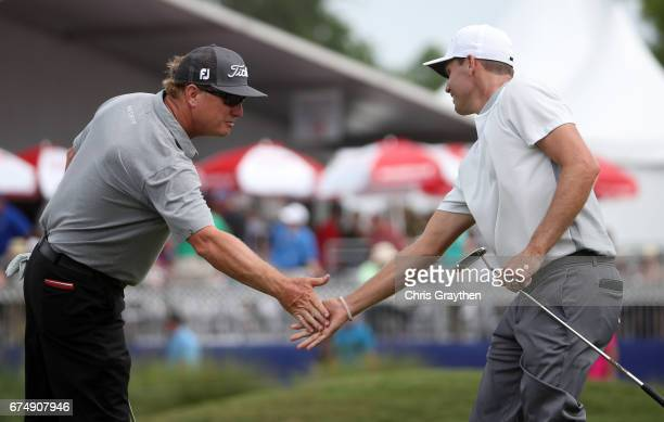 Nick Watney and Charley Hoffman react after they putt on the 14th hole during the third round of the Zurich Classic at TPC Louisiana on April 29 2017...