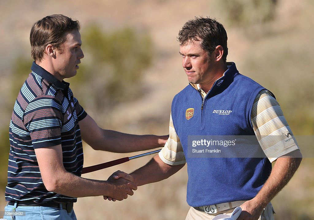 Nick Watney and Lee Westwood of England shake hands on the 18th hole during the second round of the Accenture Match Play Championship at the Ritz-Carlton Golf Club on February 24, 2011 in Marana, Arizona.