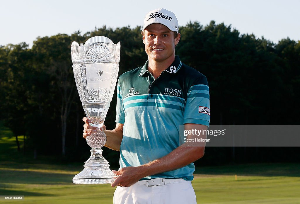 Nick Watney celebrates with the trophy after his threestroke victory at The Barclays at the Black Course at Bethpage State Park August 26 2012 in...