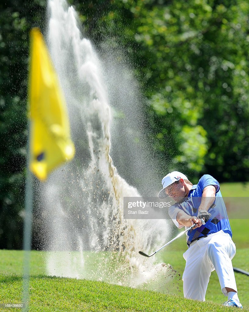 Nick Watney hits from a bunker on the eighth hole during the first round of THE PLAYERS Championship on THE PLAYERS Stadium Course at TPC Sawgrass on May 9, 2013 in Ponte Vedra Beach, Florida.