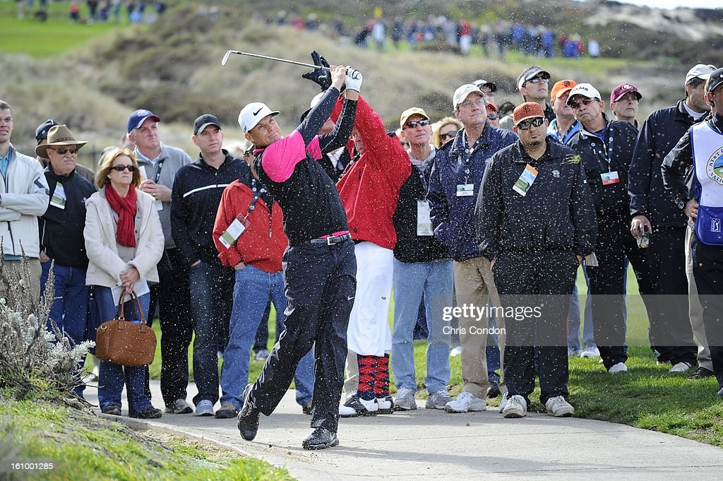 Nick Watney hits from a cart path on the 4th hole during the second round of the AT&T Pebble Beach National Pro-Am at Spyglass Hill Golf Course on February 8, 2013 in Pebble Beach, California.
